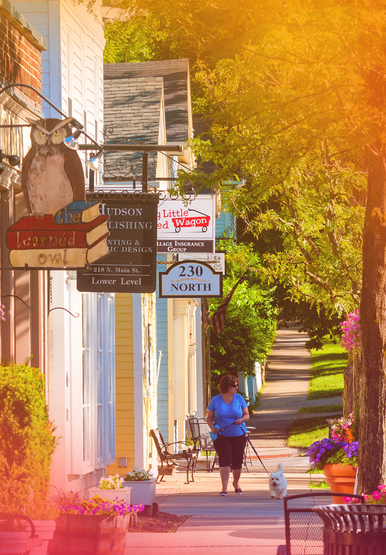 woman walks along the sidewalk in historic roswell